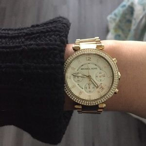 Gold Michael Kors watch with pave diamond face